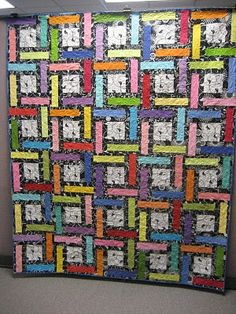 love the black and white printsmixed with bright solids. this one is going on my long list of quilts to do before I die.