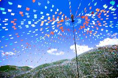 Prayer flags dot the hillside at Tagong Grasslands, China Stuart Beesley of Stock, Essex