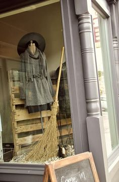 Whimsy... great halloween window.  celebrate the holiday but don't hit people over the head with pumpkins & black cats.  thoughtful!!!