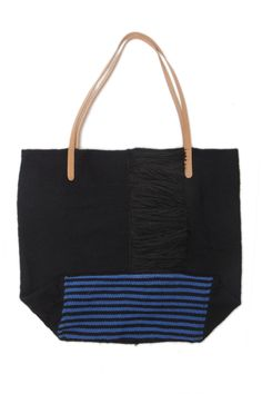 """Alpaca Fringe Tote by Proud Mary. Wool and alpaca handwoven tote with side fringe. Leather straps; blue stripe detail on bottom. - Size: 15"""" W x 16"""" H x 6.5"""" D - Handwoven in Peru"""