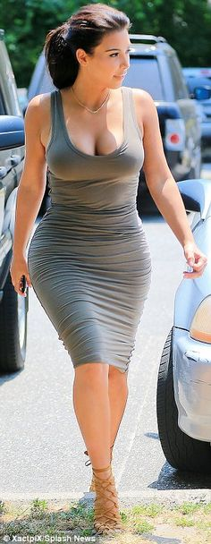 Taking the plunge: The low-scooping neckline of the dress allowed Kim to display her ample cleavage
