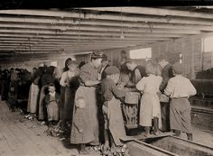 "Lewis Hine Photographer 1908/1912:  Seafood Workers: Oyster shuckers working in a canning factory. All but the very smallest babies work. Began work at 3:30 a.m. and expected to work until 5 p.m. The little girl in the center was working. Her mother said she is ""a real help to me."" Dunbar, Louisiana."