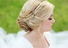 Elegant wavy bangs pulled into a twist bun with fishtail braid headband made by actual hair
