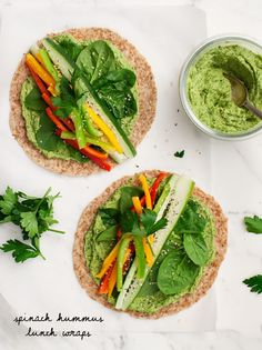 Perfect for back-to-school season or long plane rides, these vegan hummus wraps, filled with crisp veggies, are fresh and healthy.