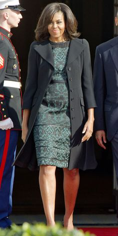 FLOTUS wore a jade green printed Tanya Taylor dress and black coat to welcome the Canadian Prime Minister to Washington D.C. March 2016