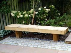 So simple. Garden landscaping by Paperbark Garden design a small garden in West Yorkshire simple timber bench seat with granite setts and hydrangea planting. Small Bench Seat, Timber Bench Seat, Table With Bench Seat, Corner Bench Seating, Storage Bench Seating, Built In Seating, Built In Bench, Landscape Design, Garden Design