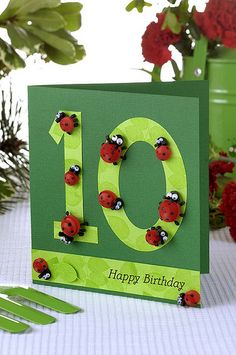 what a cute card. The lady bugs are made from quilling
