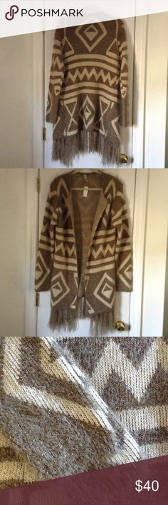 FINAL PRICE**NWTS AZTEC CARDIGAN FINAL PRICE.  THIS IS BRAND NEW STILL WITH TAGS!  pictures aren't doing this sweater any justice!  Fuzzy open collar-less sweater cardigan with Aztec design in a mocha and light tan color.  Sweater is super fuzzy with silver metallic strands weaved into the material to make this gorgeous sweater stand out and shine!  Fuzzy fringe through out bottom of cardigan!  Very thick, can also be used in place of a light jacket!  Brand new with tags! POL Sweaters…