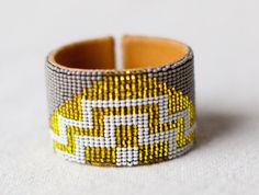 Love this cuff for summer and proceeds go to a great cause!  This cuff is handmade by expert beaders in the Lago de Atilan region.  The women work at home and go to a central house to get the beads that they need for the job. They are paid a fair wage for their work.