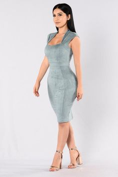 - Available in Blue Grey and Marsala - Faux Suede - Scoop Neck - Midi Length - Back Slit - Hidden Back Zipper Closure - 60% Cotton, 35% Nylon, 5% Spandex