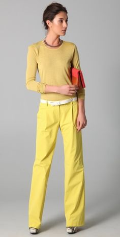 the woman in the yellow outfit