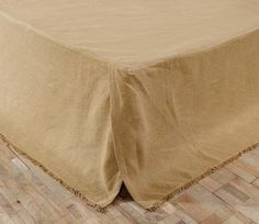Burlap Natural King Bed Skirt Our primitive country bed skirts, or dust ruffles, coordinate nicely with our quilted comforters. This Burlap Natural king bed skirt is a khaki tan. The king sized bed sk