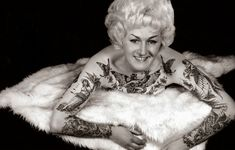 In the early 1960s, a heavily-tattooed woman called Cindy Ray became known as a pin-up, sideshow attraction, and one of Australia's first tattoo artists. The woman behind the name is Bev Nichols, who turns 73 this year.