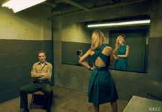 Evoking the famous interrogation scene with Lewis, Danes in a Calvin Klein Collection blue wool-flannel cross-back top and pleated skirt. Omega watch.