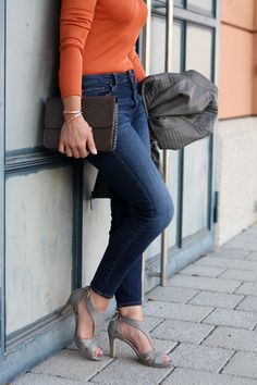How to add a feminine touch when you are wearing casual jeans and a leather jacket