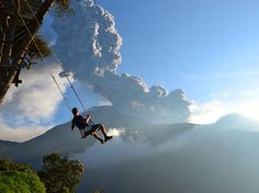 "Attached to a simple wooden tree house on an overlook near Baños de Agua Santa, Ecuador, the ""end of the world swing"" gives courageous visitors the ride of their life—an unprotected swing over a canyon. Sean Hacker Teper, who submitted this photo to the Traveler Photo Contest, got something extra: A perfect view of Mount Tungurahua erupting nearby. ""Minutes after the photo was taken, we had to evacuate the area because of an incoming ash cloud,"" he wrote."