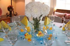 centerpieces  Made these for Syd's baby shower.  Libby Glass Outlet bowls (or Dollar Tree), Dollar tree marbles, ducks online.  You have NO IDEA how hard it is to find plain ole yellow rubber duckys!  Got lots of compliments ; )  Bought a few extra of the larger ducks to float in punch bowl and smaller ducks to scatter on the tables.  Success!
