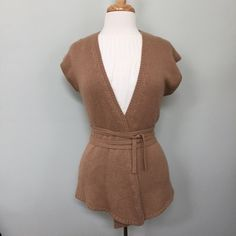 Anthropologie | Moth Tan Wrap Sweater Vest Knit vest with long belt wrap. Slight asymmetrical draping in the front. Color is tan. Great used condition. Fabric type posted in photo. Anthropologie Sweaters