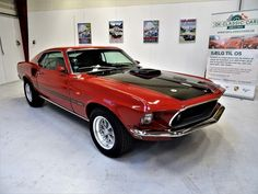 1969 Ford Mustang Mach 1 Sports Roof with original R-code Cobra Jet Ram Air engine Absolute stunning early first generation Mach 1 Mustang is great original condition including its factory Candy Apple red paint with black-out hood tr Mustang Mach 1, Ford Mustang, Ford Classic Cars, Candy Apple Red, Bucket Seats, Red Paint, Manual Transmission, Cars For Sale, The Originals