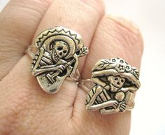 Mexican Sugar Skull Jewelry - Silver Two Finger Rings Day of the Dead. $21.90, via Etsy.