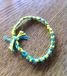 tie the ends of friendship bracelet