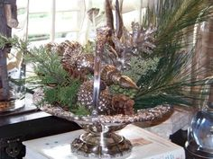 Silver basket with long needled pine, spires and textured mercury ball.