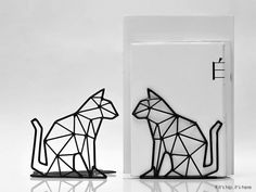 Interesting wire sculpted Der and Crane umbrella stands and animal shaped bookends by Liberte Design Studio.