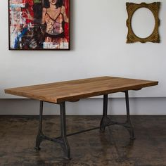 Reclaimed teak dining table with metal trestle