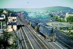 https://flic.kr/p/239J8r5 | PRR 7069 westbound; Slope Tower, Altoona PA | Six PRR GP9s, including a GP9B, are westbound at Slope Tower in Altoona. This slide is uncredited and undated. Anyone with addiitonal information is welcome to contact me.