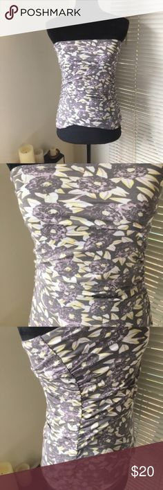 Free People strapless top Purple, yellow and grey ruched tube top from Free People. Slightly asymmetrical hem in the front. Rayon/spandex blend, machine wash, tumble dry. Free People Tops