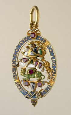 Lesser George of the Order of the Garter; double-sided enamelled gold St George on horseback about to slay the dragon with a sword, within enamelled oval gold garter border; set with four shaped diamonds and fourteen rubies. England 1628-1629.   © Trustees of the British Museum