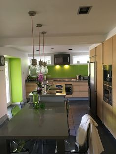 Kitchen was done as part of our original refurb but last year we spruced it up with new work tops and a new splash back. And added the accent green walls etc.