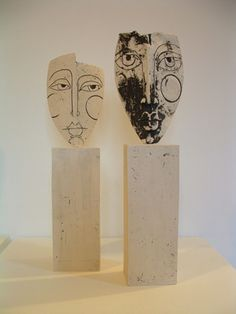 Ceramics by Sue Hanna at Studiopottery.co.uk - Two mounted stoneware heads. Produced in 2006.