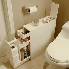 Bathroom Floor Cabinet - lots of storage in a slim little package. I kept focusing on trying to build the wall on the sink side. Didnt even think about adding storage on the wall side. A built in cabinet would be perfect.