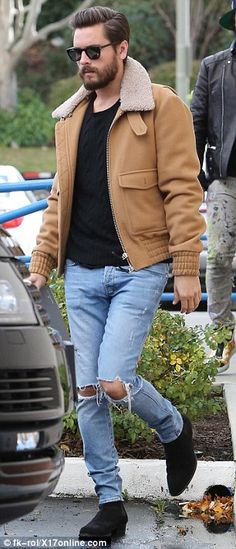 Focused: That same day, the star's ex Scott Disick was spotted leaving a business meeting...