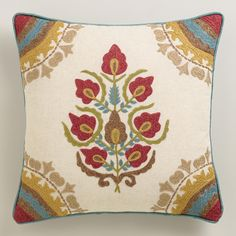 With a beautifully embroidered floral medallion at its center, our natural-hued throw pillow is an affordable way to refresh the look of your decor. Multicolored detailing in each corner, dupioni backing and red piping add just the right touches.