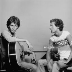 Singer-songwriters and guitarists John Walker (1943 - 2011, left) and Scott Walker, of American pop group The Walker Brothers, London, 20th July 1976.