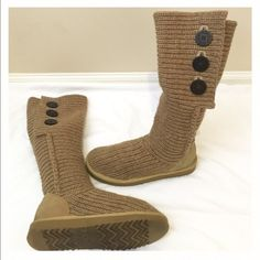 Uggs Sweater Boots Tan sweater boots with brown buttons. These are super comfy and warm. Some signs of wear on the heels as you can see in picture. Otherwise these are in good condition. Size 7, but I normally wear an 8 and these fit great! Make an offer if interested UGG Shoes Winter & Rain Boots