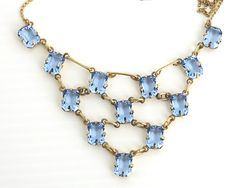 Antique 9 carat gold and blue topaz necklace with central decorative section…