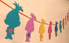 This Trolls Banner is perfect for your Trolls themed birthday party or event, or makes a great addition to any childs bedroom or play space! Banner is roughly 60 long. Ribbon color choices: - Orange (pictured) - Pink - Green - Red - Yellow - Black - Blue *****PLEASE include what color ribbon you would like as a note to seller with your order. If you do not specify a color, then one of the above listed colors will be chosen for you.*****