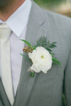 white ranunculus boutonniere for grey groomsmen outfit