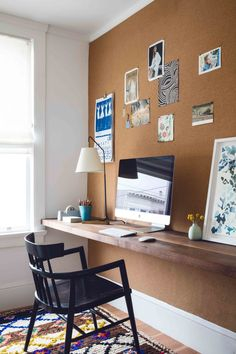 DIY a custom office wall for a cute home office space. Corkboard wallpaper feature wall has a live edge worksurface floating on the wall by KATIE MARTINEZ DESIGN