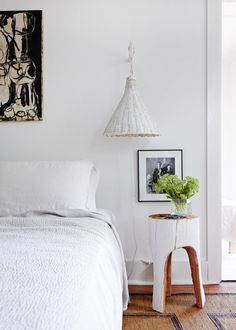 Notice proportions of lamp with low headboard and small table that pulls the eye toward it's arch separated legs. Also want to copy the way the pillows are wrapped in fabric. No break between them.