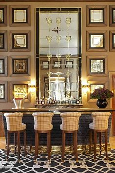 Chic living room bar features dark stained shaker cabinets paired