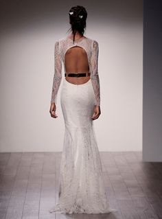 Ivory Chantilly Lace modified A-line bridal gown, bateau lace illusion neckline, long lace sheer sleeve, natural waist, low open back, crystal pearl belt, sweep train.