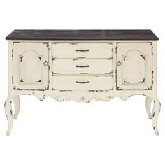 """Antiqued sideboard with a scalloped apron and cabriole legs.    Product: SideboardConstruction Material: WoodColor: WhiteFeatures:  Handmade for natural feelSpace savingThree drawersTwo doorsDistressed finish Dimensions: 33"""" H x 48"""" W x 17"""" D"""