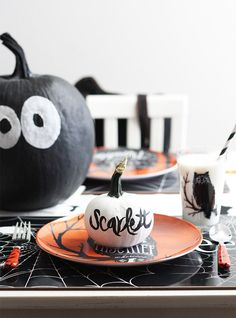 Adorable Halloween table idea -- Pumpkins painted with each guest's name!