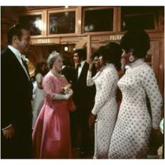 The Supremes meet the Queen Mother.