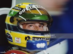 Ayrton Senna of Brazil sits aboard the Rothmans Williams Renault Williams Renault before the San Marino Grand Prix on May 1994 at the Autodromo Enzo e Dino Ferrari in Imola, San Marino. Ayrton Senna Helmet, Italy Team, San Marino Grand Prix, Alain Prost, Monaco Grand Prix, F1 Drivers, Formula One, Race Cars, Super Cars