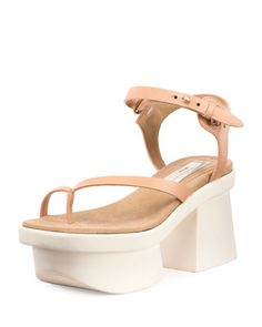 "Stella McCartney faux-leather (polyester) sandal. 3"" platform heel. Thong strap. Adjustable ankle strap. Padded footbed. Rubber outsole. ""Altea"" is made in Italy."